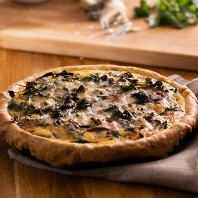 Wild mushroom, blue cheese and watercress quiche